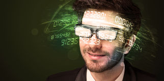 Business man looking at high tech number calculations. Concept Royalty Free Stock Photography