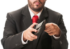 Business man looking into his wallet Royalty Free Stock Photo