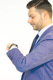 Business man looking at his watch on white background Stock Images