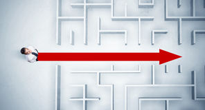 Business man looking at maze with red arrow Royalty Free Stock Photo
