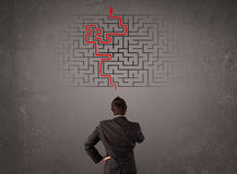 Business man looking at a maze and the way out Royalty Free Stock Image