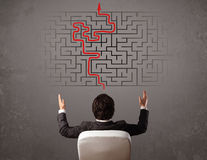Business man looking at a maze and the way out Royalty Free Stock Images