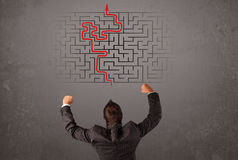 Business man looking at a maze and the way out vector illustration