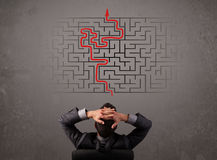 Business man looking at a maze and the way out. On brown wall vector illustration