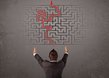 Business man looking at a maze and the way out Stock Photo