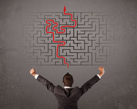 Business man looking at a maze and the way out Royalty Free Stock Photo