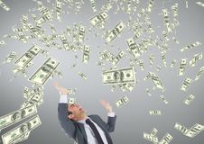 Business man looking at money rain against grey background Stock Image