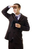 Business man looking for new opportunity. Holding binoculars, isolated on white Royalty Free Stock Image