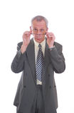 Business man looking over glasses. Photograph of business man looking over glasses isolated Stock Photo