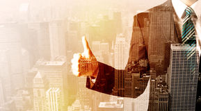 Business man looking at overlay city background. Business man looking at warm overlay city background royalty free stock image