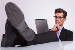 Business man looking pensively at tablet Royalty Free Stock Photos