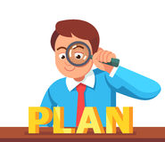 Business man looking at PLAN word Royalty Free Stock Photo