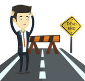 Business man looking at road sign dead end. Royalty Free Stock Images