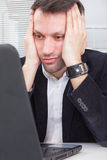 Business man looking at screen laptop computer with a shocked up Royalty Free Stock Photo