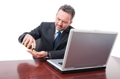 Business man looking stressed taking pills Stock Photography