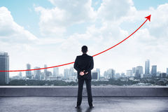 Business Man Looking To The Graph. Asian man standing looking the city watching the graph raise Royalty Free Stock Images