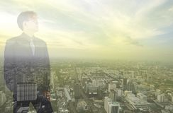Business man looking to the sky stock images