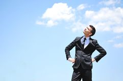 Business man looking up. On sky Royalty Free Stock Image