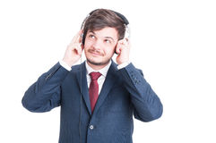 Business man looking up and listening to music Royalty Free Stock Photos