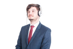Business man looking up and listening to music Royalty Free Stock Images