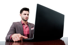 Business man looking very serious at his laptop Royalty Free Stock Photo