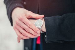 Business man looking at watch.  Royalty Free Stock Photos