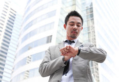 Business man looking at watch Stock Photo