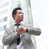 Business man looking at watch Royalty Free Stock Images