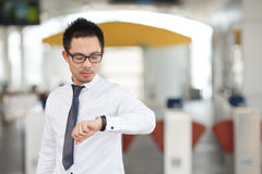 Business man looking at watch Stock Images