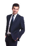 Business man looking at you, holding his hands in pocket Royalty Free Stock Photos