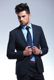 Business man looks away while holding his lapels Stock Photography