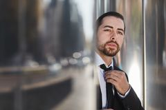 Business man looks full of doubt. And thoughtful into the future Royalty Free Stock Image