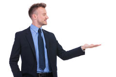 Business man looks at his opened palm Stock Photos