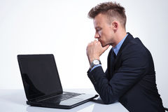 Business man looks pensively at laptop Stock Photos