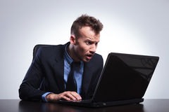 Business man looks surprised at laptop Royalty Free Stock Photos