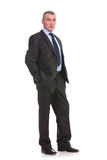 Business man looks at you with his hands in his pockets Royalty Free Stock Images