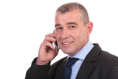 Business man looks at you while on phone Stock Photos