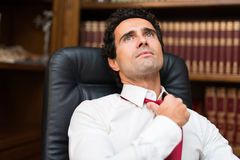Business man loosening his necktie Royalty Free Stock Photography
