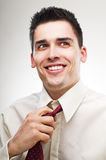 Business man loosening tie Royalty Free Stock Images