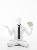 Business man in lotus position with dollars Stock Photo
