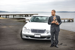Business Man Luxury Car and Dog at Lake. Next to a pier stock photo