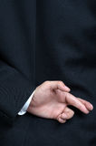 Business man lying fake Fingers Crossed. Business man lying fake hand Fingers Crossed Royalty Free Stock Photography