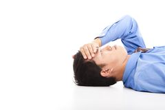 Business man lying on floor Royalty Free Stock Photo