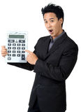 Business man Made frightened Hold Calculator Stock Photo