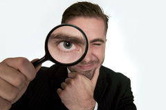 Business man with magnifying glass Royalty Free Stock Images