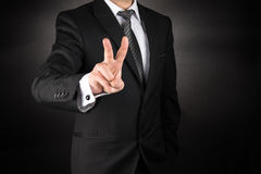 Business man make victory sign or two Royalty Free Stock Photos