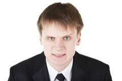 Business man makes angry scary face Stock Image