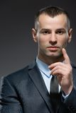 Business man making attention gesture Stock Photos