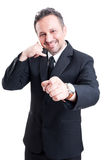 Business man making call or calling gesture Stock Photo