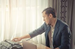 Business man making call on Fax Machine landline Stock Photo